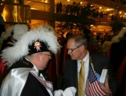 Dan Nagle speaks with members of the K of C color guard at Flight of Honor Reception